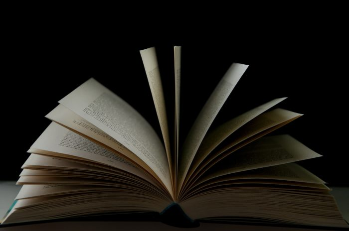 white book page with black background